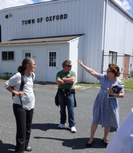 The town manager of Oxford, Maryland, points to flooding zones in the distance.