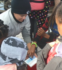 A crewmember on board the Sultana helps Dorchester County fifth graders determine how much dissolved oxygen is in Choptank River water.