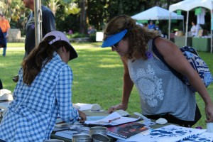 A Junior Ambassador educates a visitor about Biscayne Bay at a local outreach event.