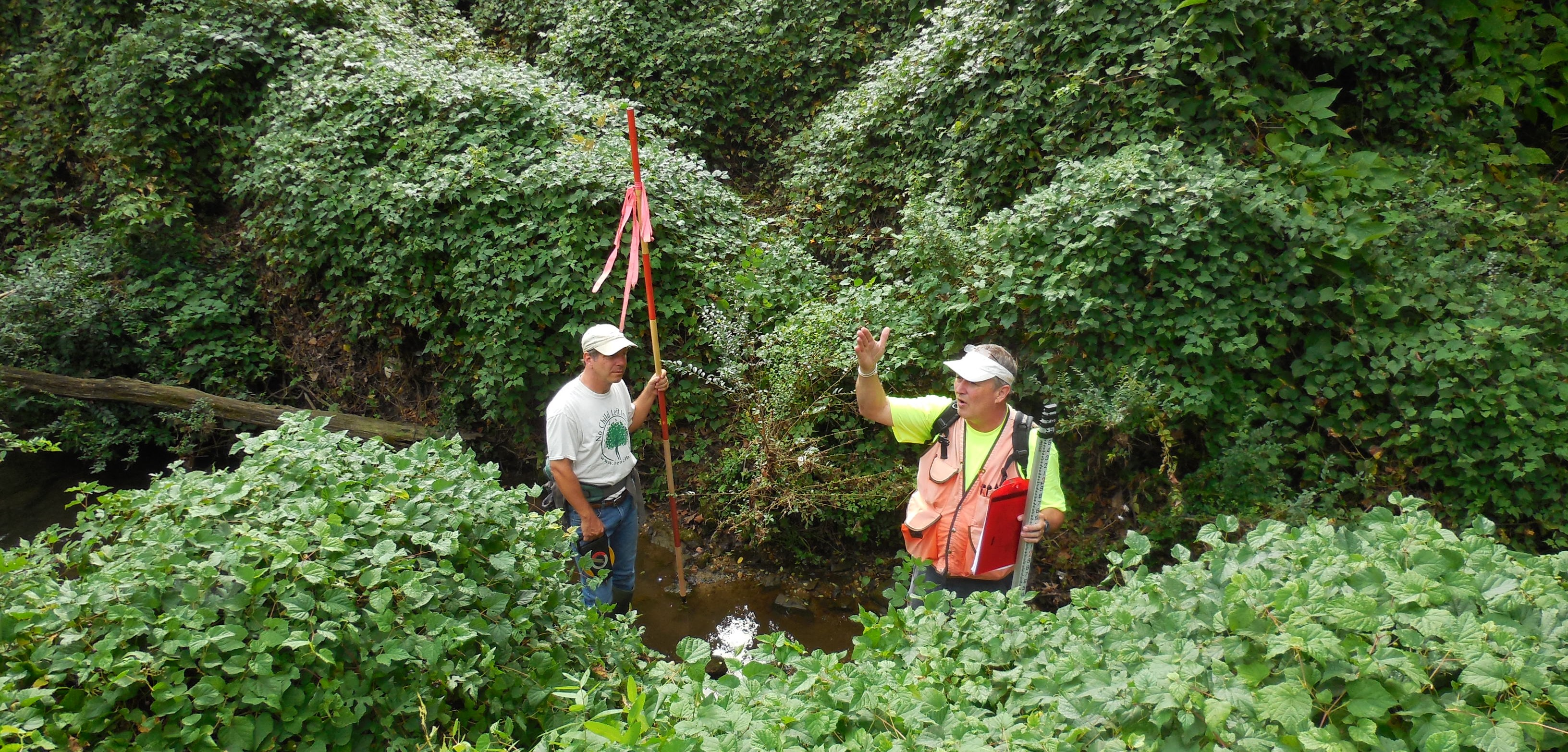 Sea Grant Extension Watershed Specialist Eric Buehl (right) and Chesapeake Bay Foundation Restoration Scientist Rob Schnabel assist with a stream assessment in the Town of Easton as part of an Envision the Choptank grant application to design two stream restoration projects. Credit: Sarah Hilderbrand, MD DNR.