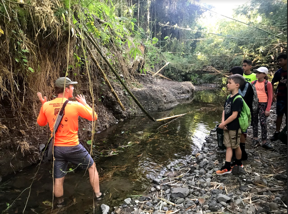 Children at Manell-Geus Habitat Focus Area Kids Camp learned about stream bank erosion and invasive bamboo species as major contributors to village flooding.