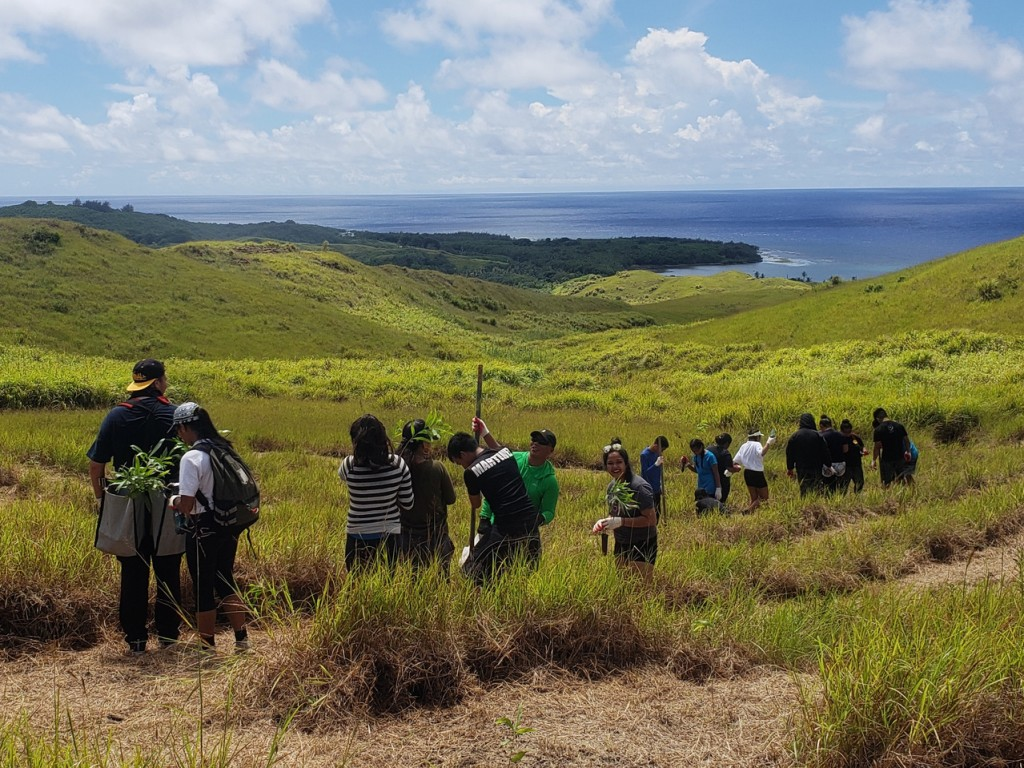 Community members in Manell-Geus Habitat Focus Area forest restoration efforts. Photo: Guam BSP/Patrick Keeler.